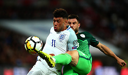 Alex Oxlade-Chamberlain of England is tackled by Bojan Jokic of Slovenia - Mandatory by-line: Robbie Stephenson/JMP - 05/10/2017 - FOOTBALL - Wembley Stadium - London, United Kingdom - England v Slovenia - World Cup qualifier