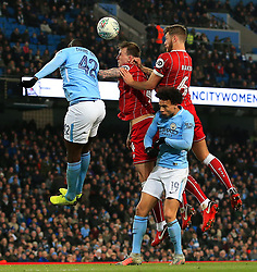 Nathan Baker and Aden Flint of Bristol City win a header above Yaya Toure and Leroy Sane of Manchester City - Mandatory by-line: Matt McNulty/JMP - 09/01/2018 - FOOTBALL - Etihad Stadium - Manchester, England - Manchester City v Bristol City - Carabao Cup Semi-Final First Leg