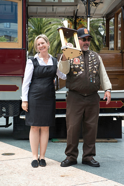 Ken Lunardi accepts his 2nd place trophy from Vice Chairman of the SFMTA Board of Directors Cheryl Brinkman at the 50th Cable Car Bell Ringing Competition.  Lunardi, competing since 1985, hold's three Champion Bell Ringing titles, eight 2nd place wins, and 3 thrid place wins. | July 11, 2013