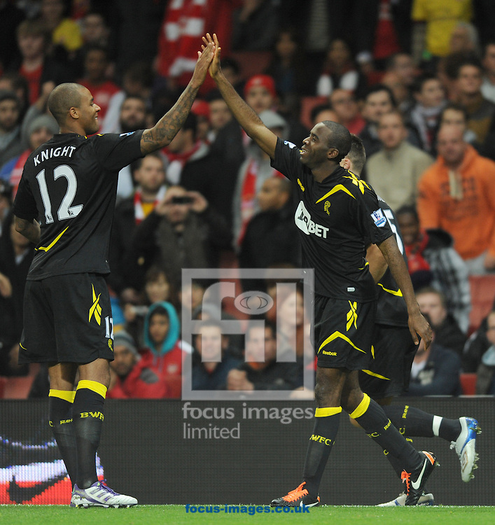 Picture by Daniel Hambury/Focus Images Ltd. 07813 022858.25/10/11.Fabrice Muamba (right) of Bolton celebrates with team mates after scoring his sides first goal during the Carling Cup Fourth Round match at Emirates stadium, London.