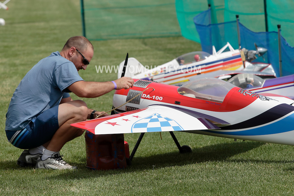 New Hampton, New York - A man works on his remote controlled airplane at a fly-in sponsored by the Wawayanda Flying Club on June 5, 2010.