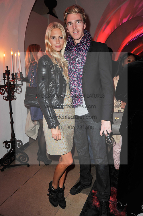 POPPY DELEVINGNE and JAMES COOK at a fashion show & party to celebrate the launch of the Vanessa G label held at the Banqueting Hall, Whitehall, London on 23rd March 2011.