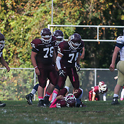 Concord offensive tackles walk over to assist quarterback Robert White (16) who took hit from Salesianum defensive end Kyle Cathers (92) Saturday, Oct. 17, 2015 at Concord Stadium in Wilmington.