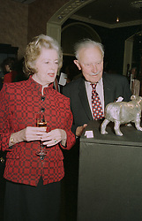 LADY BARING and LORD MICHAEL FITZALLAN-HOWARD,  at an exhibition in London on April 24th 1997.LXY 27