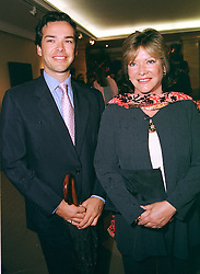 LADY ASHCOMBE and her son MR HENRY DENT-BROCKLEHURST,<br />  at a party in London on 22nd June 2000.OFS 29
