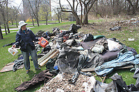 Hyde Park residents and Jackson Park Advisory Council members, Loise Mcurry and Frances Vandervoort spent Sunday afternoon cleaning out the Midway by the tracks at 59th and Stony Island where squatters had left various items and people had dumped items like old mattresses.<br /> <br /> 2182 – Frances Vandervoort shows off some of the garbage that was collected.