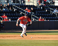 Ole Miss third baseman Matt Smith makes an error vs. Louisiana-Monroe at Oxford-University Stadium in Oxford, Miss. on Friday, February 19, 2010.