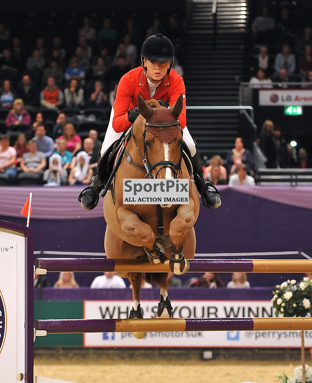 Ellen Whitaker on Arena UK Lando competing in the Leading Show Jumper of The Year.<br /> Taken at the 2013 International Horse of the year show on the 13th October2013 at the LG Arena (NEC) in Birmingham.<br /> WAYNE NEAL | SPORTPIX.ORG.UK