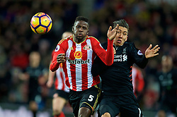 SUNDERLAND, ENGLAND - Monday, January 2, 2017: Liverpool's Roberto Firmino in action against Sunderland's Paps Djilobodji during the FA Premier League match at the Stadium of Light. (Pic by David Rawcliffe/Propaganda)