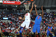 "Mississippi's Aaron Jones (34) scores vs. Florida at the C.M. ""Tad"" Smith Coliseum in Oxford, Miss. on Saturday, February 22, 2014. Florida won 75-71.  (AP Photo/Oxford Eagle, Bruce Newman)"