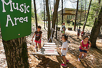 Children make music at Prescott Farm's Natural Playscape on Saturday morning following the grand opening celebration.  (Karen Bobotas/for the Laconia Daily Sun)