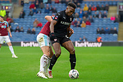 Barnsley defender Dimitri Cavare  (12) holds off Burnley defender Charlie Taylor (3) during the The FA Cup 3rd round match between Burnley and Barnsley at Turf Moor, Burnley, England on 5 January 2019.