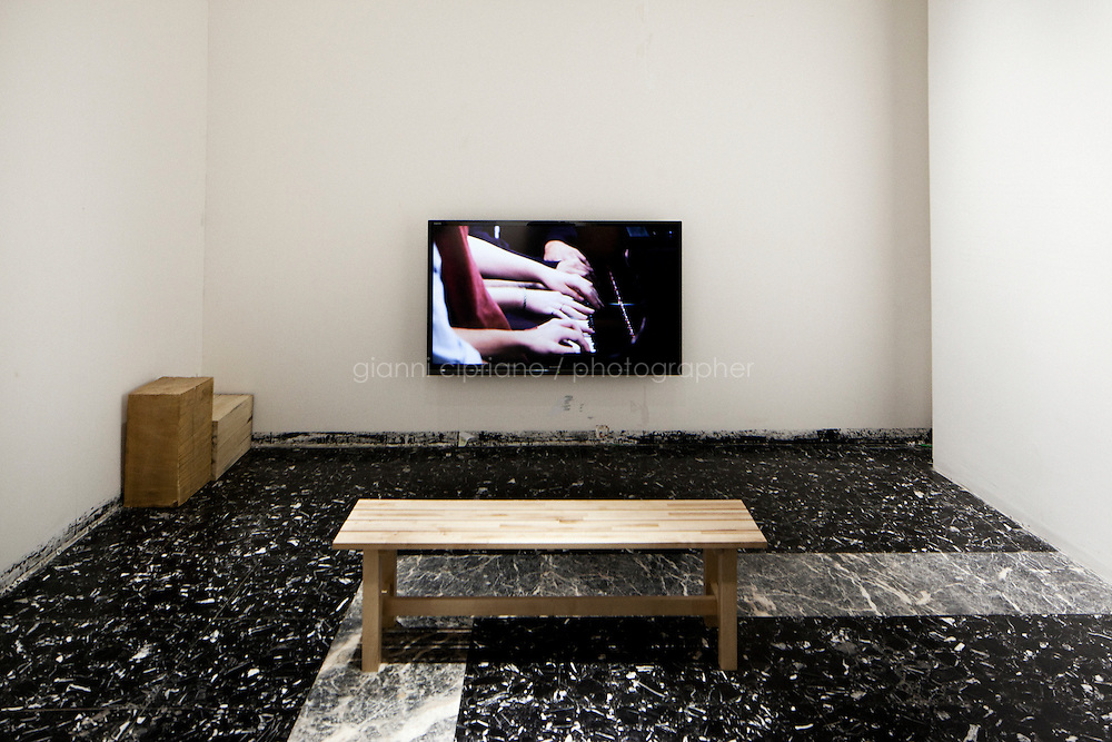 VENICE, ITALY - 29 MAY 2013:Koki Tanaka's &quot;A piano played by 5 pianists at once (first attempt), 2012, as part of &quot;Abstract speaking - sharing uncertainty and collective acts&quot;, is shown at the Japan pavillon, Giardini of the Biennale, in Venice, Italy, on May 29th 20113. <br /> <br /> In recent years Koki Tanaka has employed a variety if methods to produces works on the relationality that arises between human beings. For these works, he either sets a specific group a certain task and videos their collaboration, or does something with somebody based on an idea not yet completely formed, and records this in photos and text. On 11 March 2011, Japan experienced a massive earthquake and tsunami, plus an accident at a nuclear power plant. The tasks and acts in Tonaka's videos seem a metaphor for working together to build a post-quake society.<br /> <br /> The 55th International Art Exhibition of the Venice Biennale takes place in Venice from June 1st to November 24th, 2013 at the Giardini and at the Arsenale as well as in various venues the city. <br /> <br /> Gianni Cipriano for The New York TImes