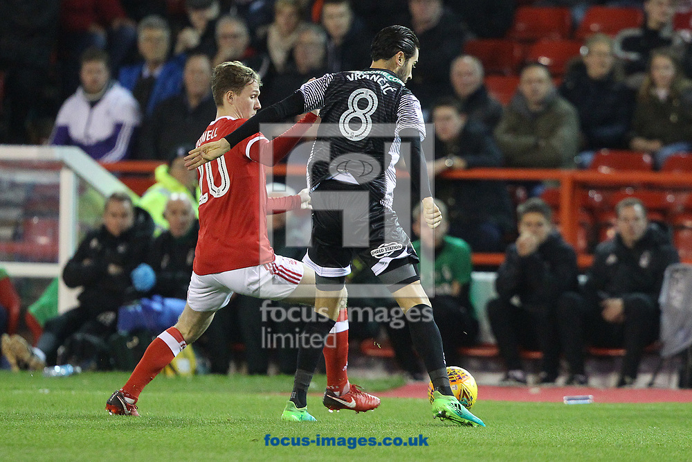 Kieran Dowell of Nottingham Forest and Mario Vrancic of Norwich in action during the Sky Bet Championship match at the City Ground, Nottingham<br /> Picture by Paul Chesterton/Focus Images Ltd +44 7904 640267<br /> 21/11/2017