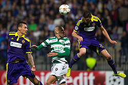 Islam Slimani of Sporting vs Aleksander Rajcevic of Maribor and Soares Bordignon Arghus of Maribor during football match between NK Maribor and Sporting Lisbon (POR) in Group G of Group Stage of UEFA Champions League 2014/15, on September 17, 2014 in Stadium Ljudski vrt, Maribor, Slovenia. Photo by Matic Klansek Velej  / Sportida.com