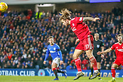 Stevie May of Aberdeen FC clears with his head  during the William Hill Scottish Cup quarter final replay match between Rangers and Aberdeen at Ibrox, Glasgow, Scotland on 12 March 2019.