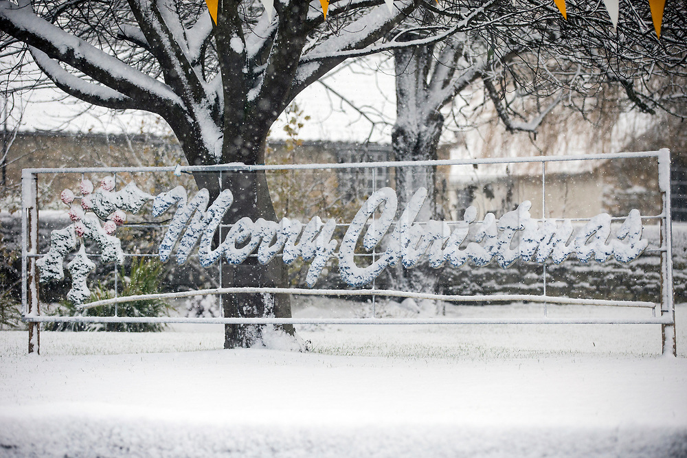 © Licensed to London News Pictures. 30/11/2017. Thornton Le-Dale UK. Picture shows a snow covered merry Christmas sign this morning after a night of heavy snow this in the village of Thornton Le-Dale in North Yorkshire.Photo credit: Andrew McCaren/LNP