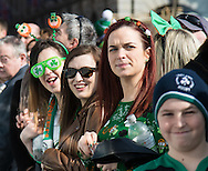 Spectators wearing Irish themed clothing and accessories line the route during the St Patrick's Day Parade in Westminster, London.<br /> Picture by Paul Davey/Focus Images Ltd +447966 016296<br /> 13/03/2016