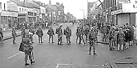 British soldiers confront loyalists on Shankill Road, Belfast, N Ireland, following an outbreak of violence which was triggered by Protestant supporters of Linfield FC, attacking the predominently Roman Catholic Unity Flats on their way home from a match on Saturday 26th September 1970. The disturbances continued into the third day. 197009260349c<br />