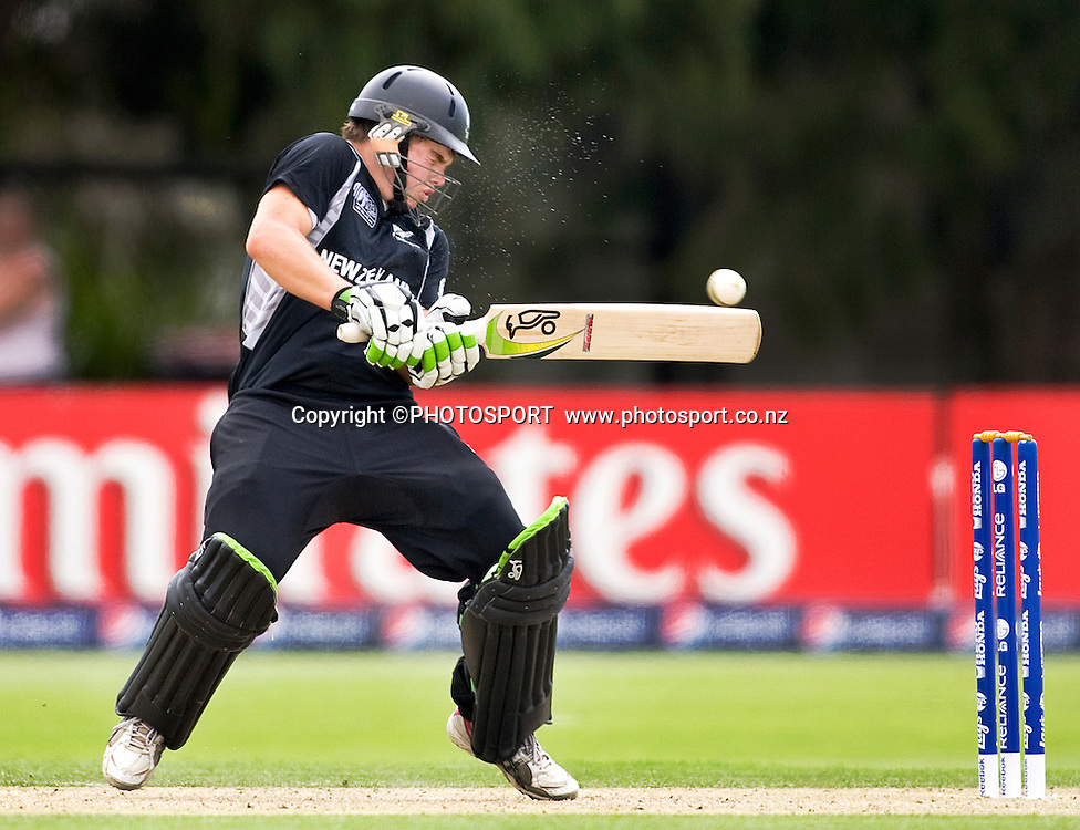 New Zealand's Tom Latham is hit in the helmet off the bowling of Tendai Chitara late in the New Zealand innings. New Zealand v Zimbabwe, U19 Cricket World Cup group stage match, Bert Sutcliffe Oval, Lincoln, Tuesday 19 January 2010. Photo : Joseph Johnson/PHOTOSPORT