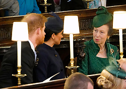 The Duke and Duchess of Sussex with the Princess Royal (right) in their seats ahead of the wedding of Princess Eugenie to Jack Brooksbank at St George's Chapel in Windsor Castle.