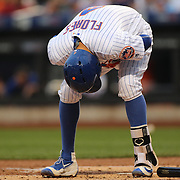 NEW YORK, NEW YORK - June 16: Wilmer Flores #4 of the New York Mets reacts after being hit by a pitch from Juan Nicasio #12 of the Pittsburgh Pirates during the Pittsburgh Pirates Vs New York Mets regular season MLB game at Citi Field on June 16, 2016 in New York City. (Photo by Tim Clayton/Corbis via Getty Images)