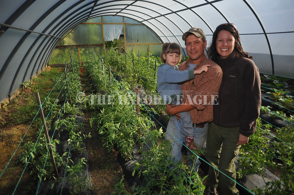 Jodi Seth (right) and Brad Solomon (center) and their daughter Willow at Old Thyme Farms near Oxford, Miss. on Thursday, April 19, 2012.