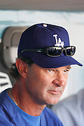 LOS ANGELES, CA - APRIL 15:  Manager Don Mattingly #8 of the Los Angeles Dodgers looks on during the game between the St. Louis Cardinals and the Los Angeles Dodgers on Friday April 15, 2011 at Dodger Stadium in Los Angeles, California. (Photo by Paul Spinelli/MLB Photos via Getty Images) *** Local Caption *** Don Mattingly