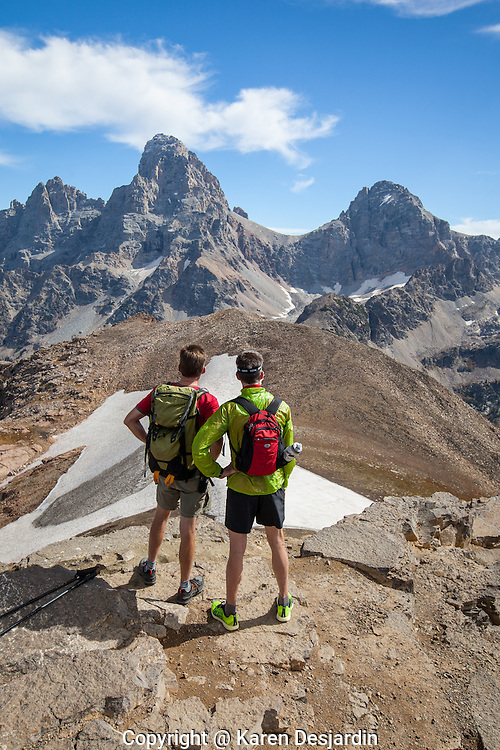 Two hikers pause at the top of Table Mountain, Wyoming, to take in the view of the Grand Teton in Teton National Park. http://www.gettyimages.com/detail/photo/hikers-take-in-view-of-grand-teton-wy-high-res-stock-photography/516032907