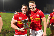 Canadian players Jamie Mackenzie and Conor Trainor with the trophy for winning the tournament and qualifying for the world cup during the Rugby World Cup qualifier between Hong Kong and Canada at Stade Delort, Marseilles, France on 23 November 2018. Picture by Ian  Muir.