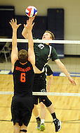 Pennridge's Aaron Nelson #27 strikes a volley against Hempfield's Tyler Butterbaugh #6 during the first round PIAA state volleyball game between Hempfield and Pennridge at Quakertown High School Wednesday May 27, 2015 in Quakertown, Pennsylvania. Hemp field defeated Pennridge 3-0. (Photo by William Thomas Cain/Cain Images)