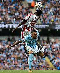 Mame Biram Diouf of Stoke City challenges Nicolas Otamendi of Manchester City - Mandatory by-line: Matt McNulty/JMP - 14/10/2017 - FOOTBALL - Etihad Stadium - Manchester, England - Manchester City v Stoke City - Premier League