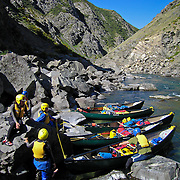 Students wait by their canoes during a portage on the Clarence River, on the South Island, New Zealand, during a  semester course with the National Outdoor Leadership School.  Photo by Jen Klewitz © 2008