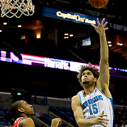 Jan 1, 2013; New Orleans, LA, USA; New Orleans Hornets center Robin Lopez (15) shoots over Atlanta Hawks center Al Horford (15) during the first quarter of a game at the New Orleans Arena. Mandatory Credit: Derick E. Hingle-USA TODAY Sports
