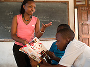 Rebeca Gyumi  (pictured left) is leading an after school Femina club in Dar Es Salaam, Tanzania. VSO is working in partnership with Femina, who are a multimedia, civil society initiative working across Tanzania to promote healthy lifestyles, HIV/AIDS prevention, sexual health, gender equality and civic education. Also pictured Paul Shayo