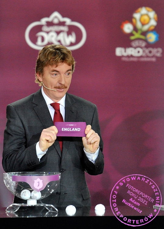 ZBIGNIEW BONIEK (POLAND) SHOWS THE TICKET OF ENGLAND DURING THE EUFA EURO 2012 QUALIFYING DRAW IN PALACE SCIENCE AND CULTURE IN WARSAW, POLAND..THE 2012 EUROPEAN SOCCER CHAMPIONSHIP WILL BE HOSTED BY POLAND AND UKRAINE...WARSAW, POLAND , FEBRUARY 07, 2010..( PHOTO BY ADAM NURKIEWICZ / MEDIASPORT )..PICTURE ALSO AVAIBLE IN RAW OR TIFF FORMAT ON SPECIAL REQUEST.