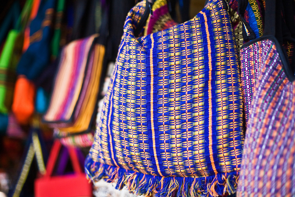 Colorful bags for sale in the market in Masaya. Masaya is close to Granada in Nicaragua. Masaya is famous for its art markets where it sells crafts from the surrounding region. It is also a major regional transport hub.