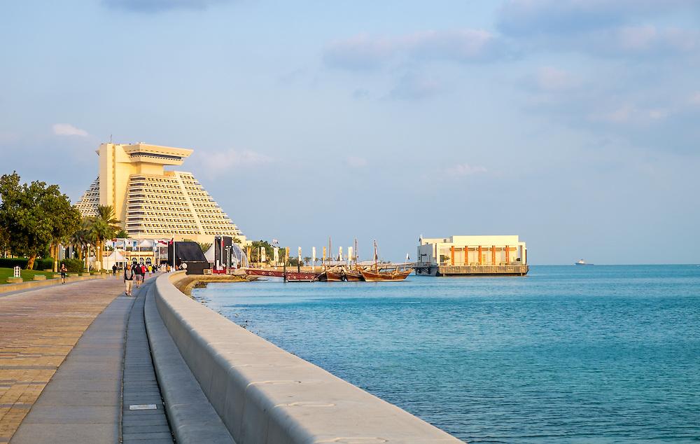 DOHA, QATAR - CIRCA DECEMBER 2013: View of the Corniche promenade and the Sheraton Doha.