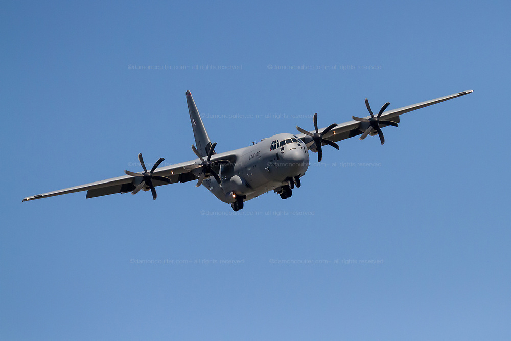 A Lockheed Martin C-130J Super Hercules with the United States Airforce flying near Naval Air Facility, Atsugi in Yamato, Kanagawa, Japan. Thursday April 11th 2019
