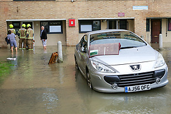 © Licensed to London News Pictures. 08/10/2019. London, UK.  A car is submerged in the water in Theobalds Court following a burst water main on Brownswood Road in Finsbury Park, north London. Photo credit: Dinendra Haria/LNP
