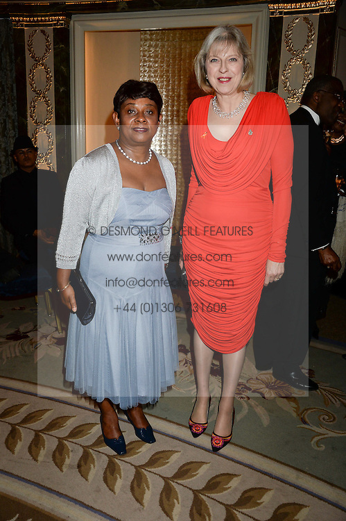 Left to right, BARONESS LAWRENCE OF CLARENDON and the Home Secretary THERESA MAY MP at the inaugural Stephen Lawrence Memorial Ball held at The Dorchester, Park Lane, London on 17th October 2013.