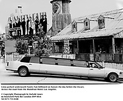 Limo parked underneath Vanity Fair billboard on Sunset the day before the Oscars. Across the road from the Mondrian Hotel. Los Angeles.<br /> <br /> &copy; Copyright Photograph by Dafydd Jones<br /> 66 Stockwell Park Rd. London SW9 0DA<br /> Tel 0171 733 0108<br /> Mortons,  Los Angeles