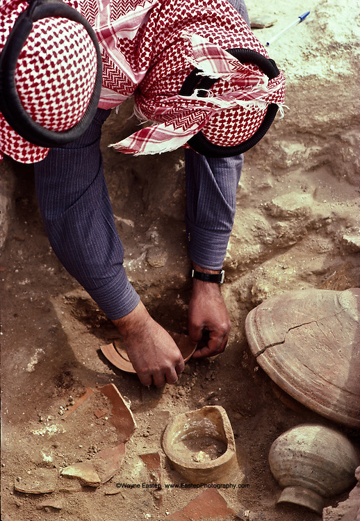 Saudi Archeologists Abduf Jawwad and S. Muard excavating a Neolithic house , 1st or 2nd c. B.C. within the ancient inner city at Thaj, Saudi Arabia