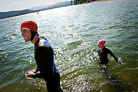 JEROME POLLOS/Press..Kip Sharbono prepares for a swim in Lake Coeur d'Alene while sister Kai gets used to the cold water Tuesday at Independence Point. Both will be competing in the Ford Ironman Coeur d'Alene on Sunday.