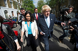 © London News Pictures. 07/05/2015. Mayor of London BORIS JOHNSON and his wife MARINE WHEELER surrounded by media as he leaves his local polling station in Islington, North London, after voting on the day that the UK goes to the polls in the 2015 general election. Photo credit: Ben Cawthra/LNP