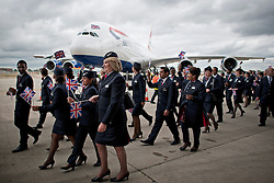 © London News Pictures.  04/07/2013 . London, UK.  British Airways staff walk in front of the new British Airways AIRBUS A380 superjumbo as it arrives at Heathrow Airport. It was the first time British Airlines have taken delivery of the new plane, making British Airways the first European airline to operate both the 787 and A380. Photo credit : Ben Cawthra/LNP
