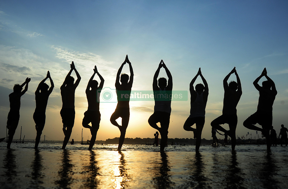 June 20, 2017 - Allahabad, Uttar Pradesh, India - Indian Youth perform yoga on the eve of International Yoga day at Sangam, the confluence of River Ganga, Yamuna and Mythological Saraswati during Sunset in Allahabad. (Credit Image: © Prabhat Kumar Verma via ZUMA Wire)
