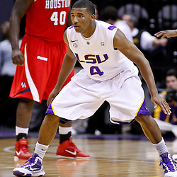 November 30, 2010; Baton Rouge, LA, USA;  LSU Tigers guard Chris Bass (4) during a game against the Houston Cougars at the Pete Maravich Assembly Center. LSU defeated Houston 73-57. Mandatory Credit: Derick E. Hingle