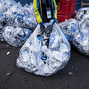 November 1, 2015 - New York, NY : A volunteer collects discarded emergency blankets along Central Park West after the 2015 TCS New York City marathon on Sunday.<br />  CREDIT: Karsten Moran for The New York TImes