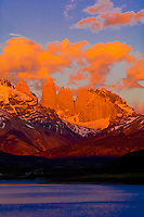 Sunrise over the Towers of Paine, Cuernos del Paine Mountains with the Bitter Lagoon  (Laguna Amarga) in foreground, Torres del Paine National Park, Patagonia, Chile